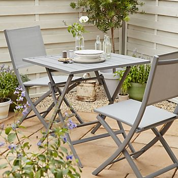 Batang folding bistro table and chairs in small garden