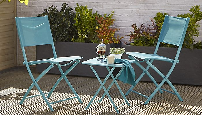 """Saba square bistro table and chairs in blue in small garden"""