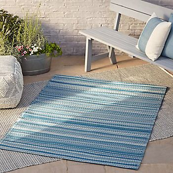 Rural outdoor rugs laid on a garden patio