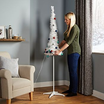 Woman putting up the 6ft Trevalli White Pop Up LED Christmas Tree