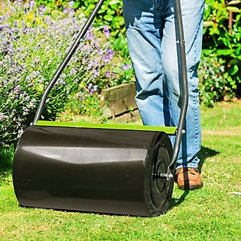 Person flattening the lawn with the Verve Pack and Flatten Lawn Roller