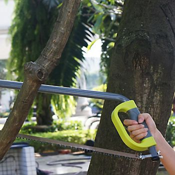 Man sawing large tree branch with a Verve bow saw