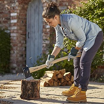Woman chopping a log with the Verve Steel Universal Axe