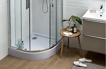 Quadrant shower enclosure with corner sliding door