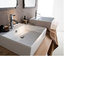 Twin countertop basins with luxury taps