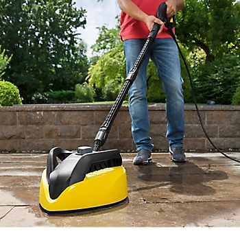 Man cleaning patio with Karcher T 450 T-Racer Surface Cleaner