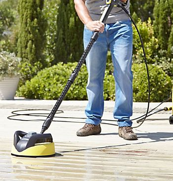 Karcher K5 Premium Full Control Pressure Washer 145 Bar cleaning a wooden deck