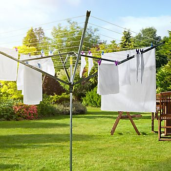 Washing drying on a rotary airer in garden