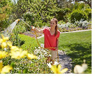 Woman using the Hozelock Spray Lance to water plants