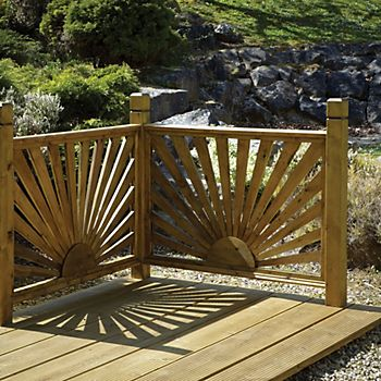 A deck with Tantalised Timber Sunburst Trellis Panels