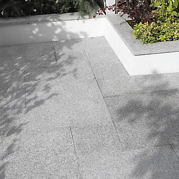 Natural granite paving slabs laid in garden patio