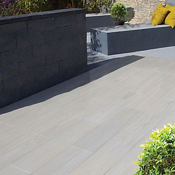 Madera Porcelain paving slabs laid with garden furniture