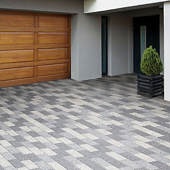Stonemaster Grey Paving Slabs laid in driveway to elongate the space