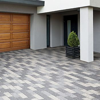 Grey paving slabs laid in a brick pattern on a driveway