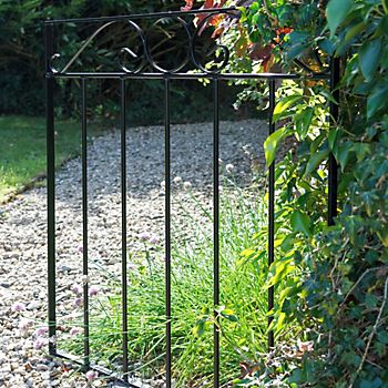 Black metal gate in a garden