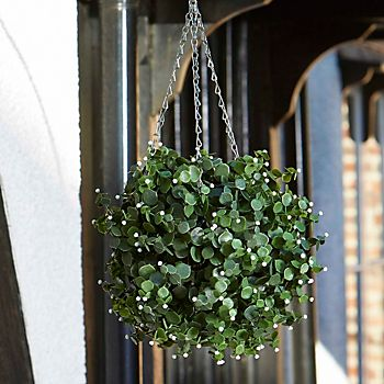 Smart Garden Flower White Artificial Topiary Ball hanging from house porch