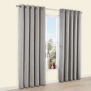 Grey chenille curtains around a window