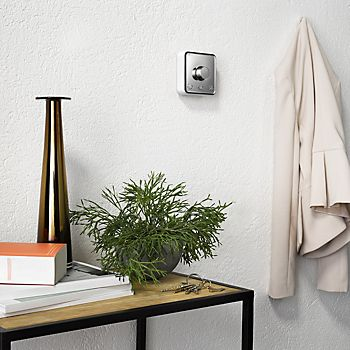 Hive Active Heating Control Thermostat on hallway wall with side table and hung coat