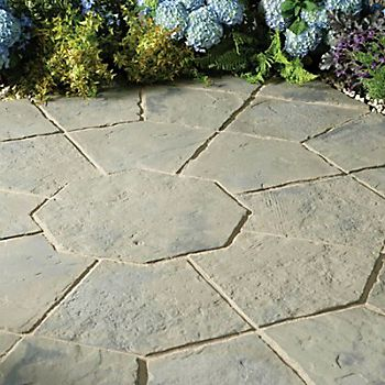 Rustic Sage Minster paving slabs laid in an octagon design with potted patio plants