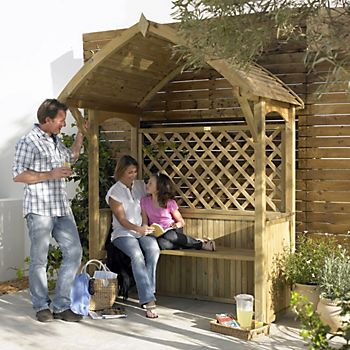 Family enjoying shade in the Barmouth Wooden Apex Arbour