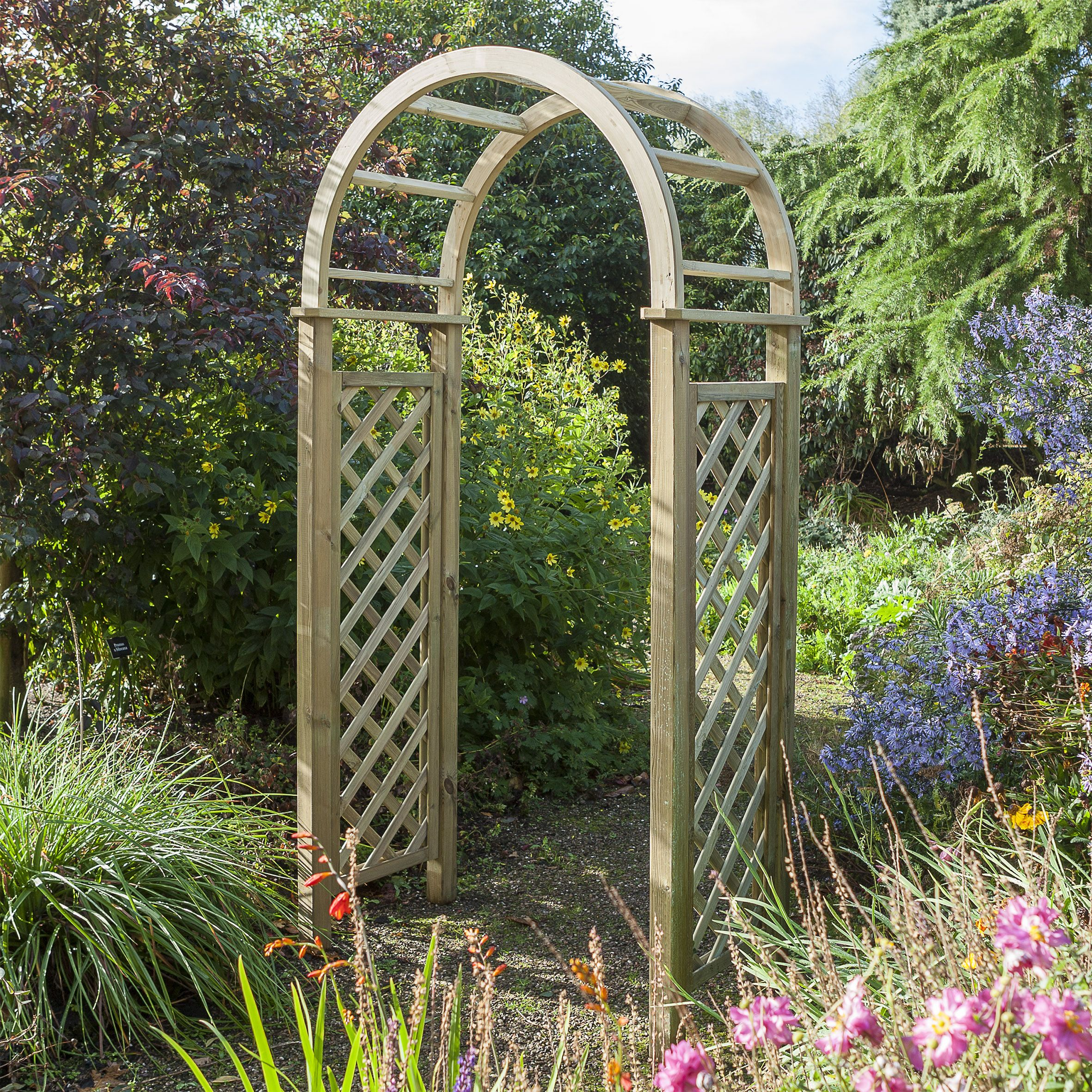 leading with photo garden area acer tulips stock and gates feature arch archway pebble tree stone into