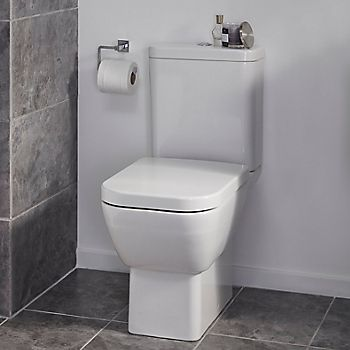 Corner toilet in a compact cloakroom
