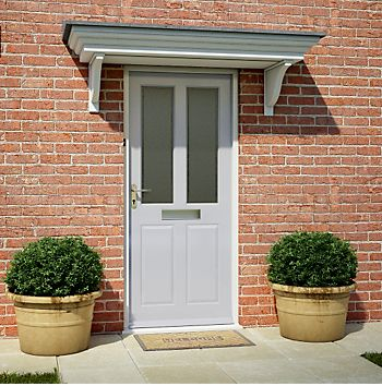 Front door with planters on both sides