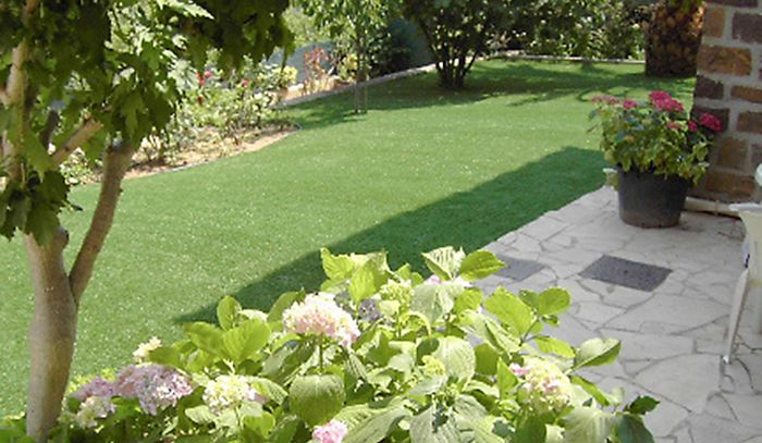 """Garden lawn laid with Banbury heavy density artificial grass"""