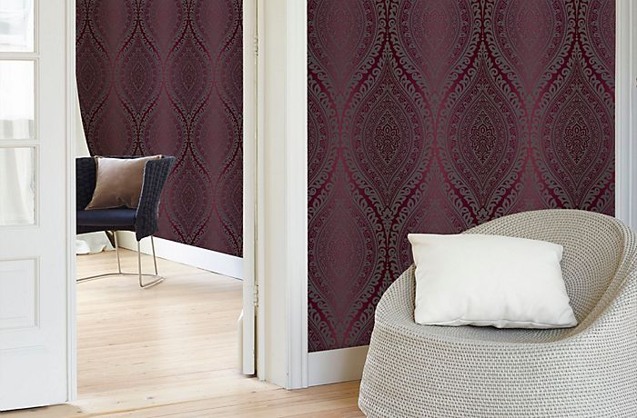 Walls papered with purple kismet wallpaper