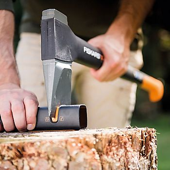 Man sharpening axe with the Fiskars Fibercomp Axe Sharpener