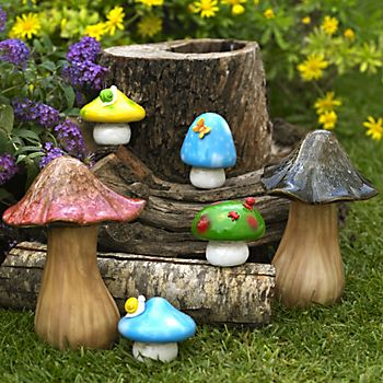 Mushroom Garden Ornament Pack displayed in cluster in garden
