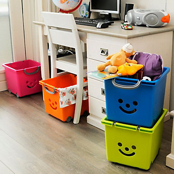 Children's plastic box storage in a study