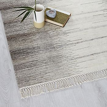 pale flooring with rug