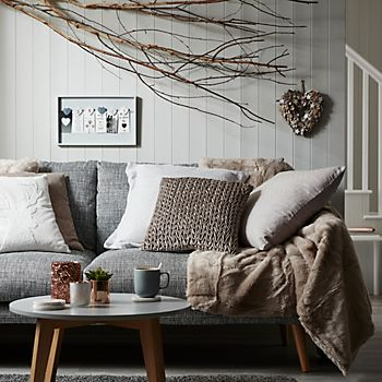 Cushions and throw on sofa
