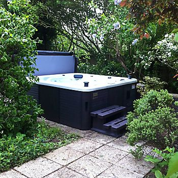 Acrylic hot tub in garden