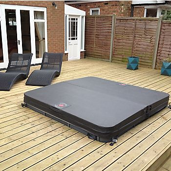 Hot tub with a cover set into decking