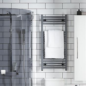 Matt grey towel radiator in bathroom