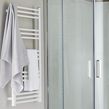 White towel warmer in shower room