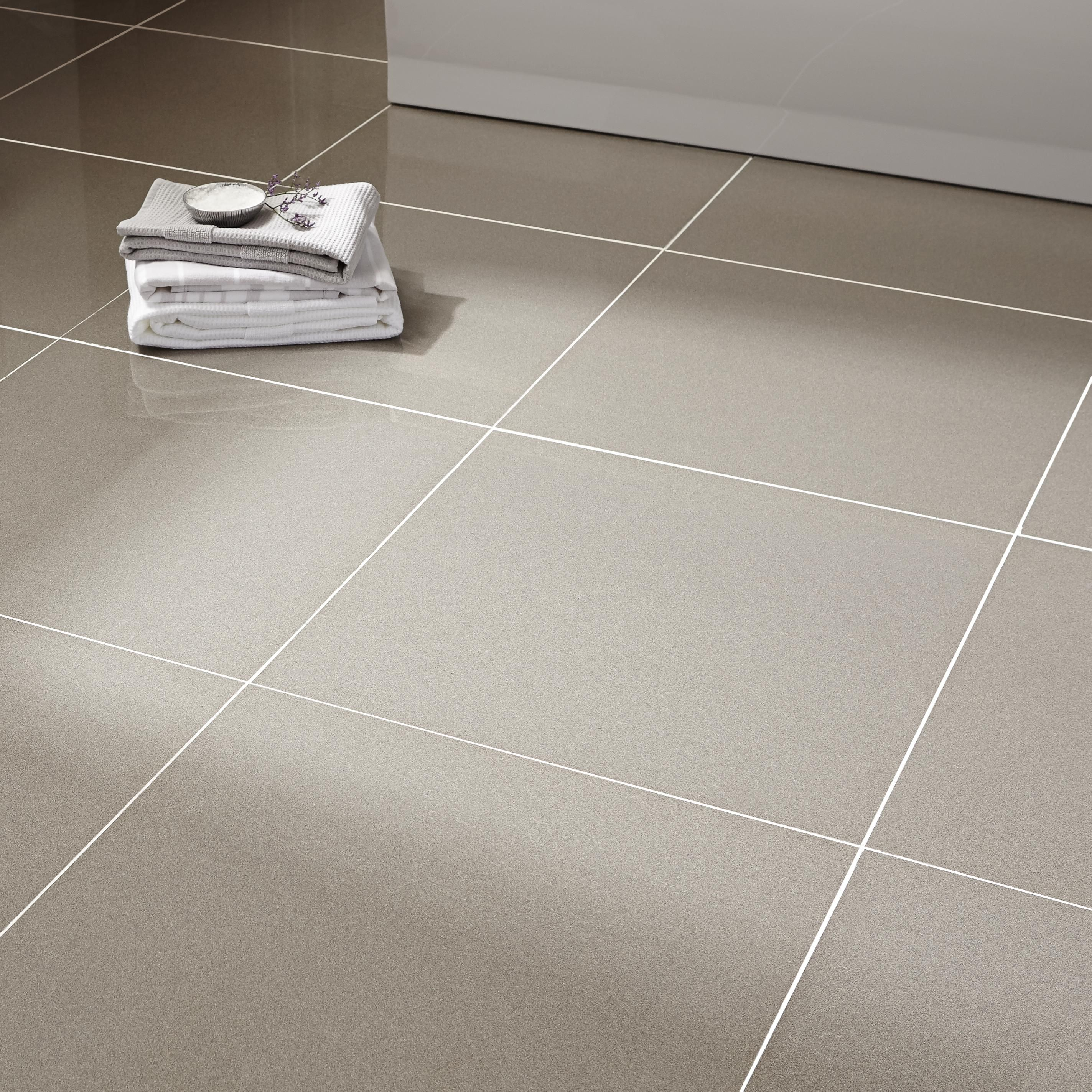 Laying tiles on walls and floors