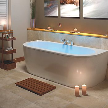 Bathroom with lit whirlpool bath and candles