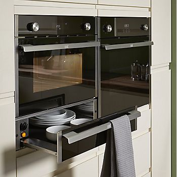 Appliance bank with ovens and warming drawer