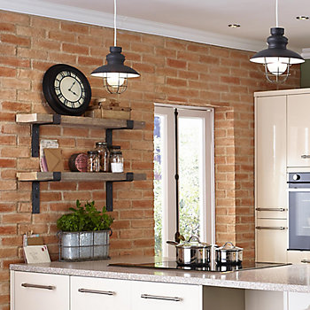 Cooke & Lewis Raffello High Gloss Cream Slab kitchen with exposed brick wall