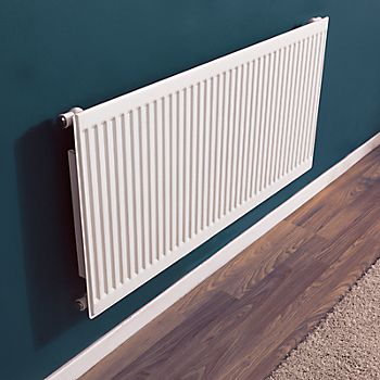white panel radiator on dark blue wall