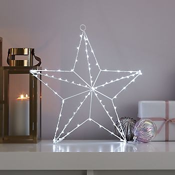Indoor star silhouette light on mantlepiece