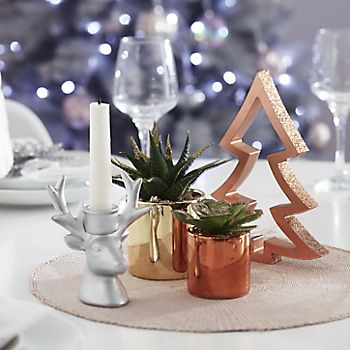Rose gold artificial plants on table