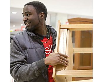 Shelter volunteer with furniture