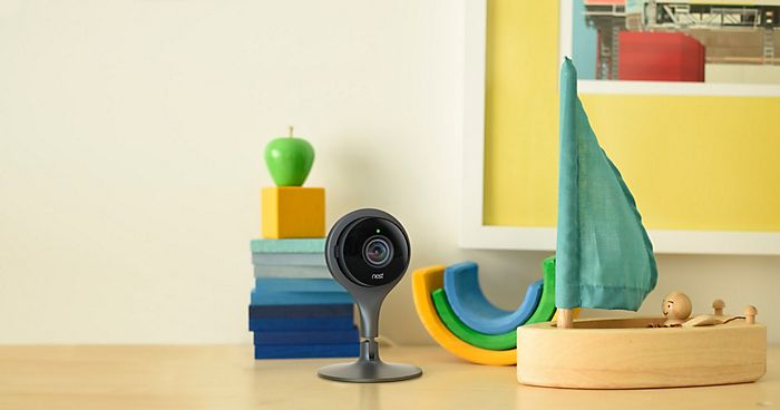 """Nest Cam camera on sideboard with children's toys"""
