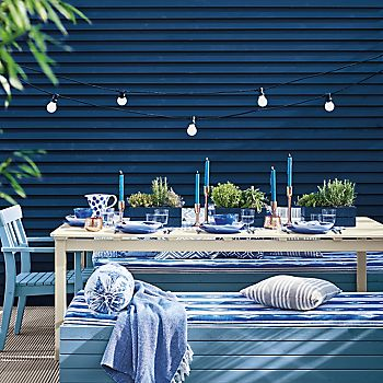 Garden dining area painted in different shades of blue