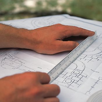 Man drawing a garden plan