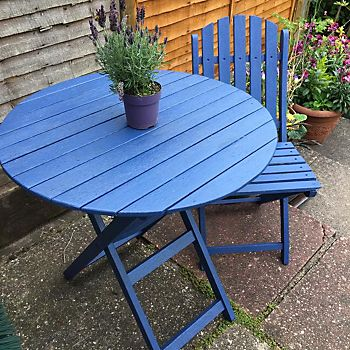 Wooden garden table and chair painted with Ronseal Bluebell Matt Garden Paint